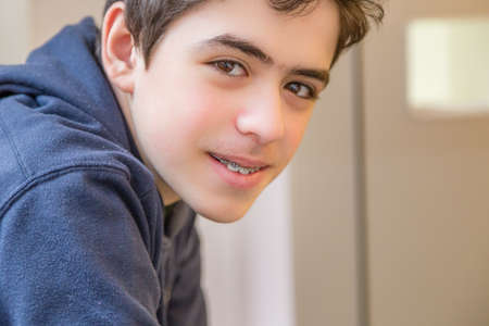 braces: caucasian boy happy and smiling with braces on teeth