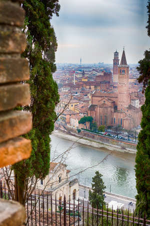 romeo: panorama of the Adige River as it passes through the houses and historical buildings of Verona in Italy, known as romantic city of love because Romeo and Juliet by Shakespeare was set here