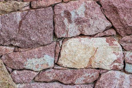 reddish: wall of reddish stones Stock Photo