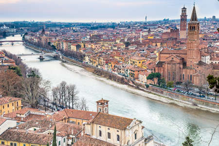 known: panorama of the Adige River as it passes through the houses and historical buildings of Verona in Italy, known as romantic city of love because Romeo and Juliet by Shakespeare was set here