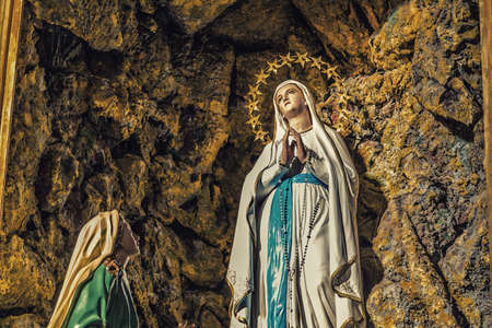 The apparition of the Blessed Virgin Mary surrounded by stars in the grotto of Lourdes