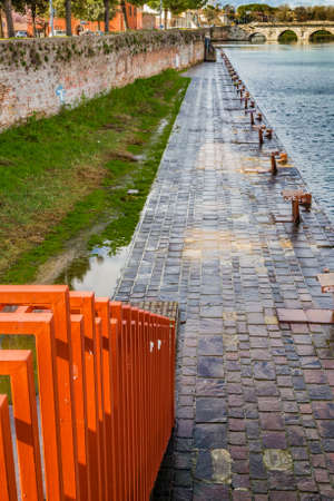 cleats: Red rusty metal stairs and cleats on the port channel of the city of Rimini in Emilia Romagna, Italy Stock Photo