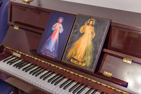 scores: the two icons of the Merciful Jesus on a piano as if they were musical scores: the Italian sentence on the bottoms means Jesus, I Trust in you