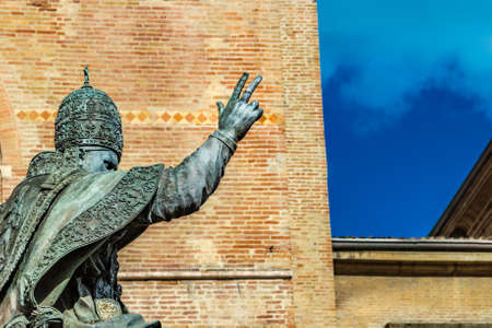 raises: statue of Pope raises his hand in blessing to the sky Stock Photo