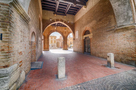 solidity: colonnade overlooking the medieval square in the center of Rimini in Italy