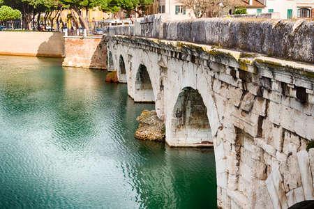 rimini: indestructible Istrian marble arches of the Roman bridge of Tiberius in Rimini