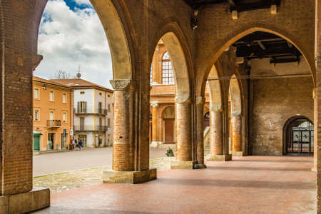 italian architecture: porches with arches and columns in the main square of Rimini in Italy