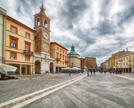 clock tower in a historical square in Rimini Banco de Imagens