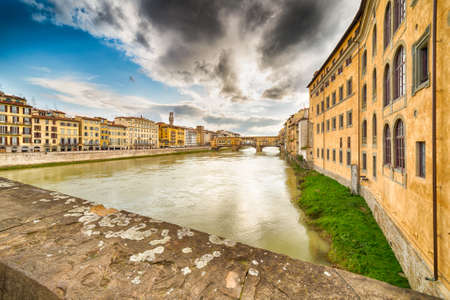 arno: bridges over the Arno river which runs through the historic buildings of Florence in Tuscany Stock Photo