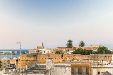 seaside town: the roofs of an ancient seaside town on the coast of the Gargano in Puglia