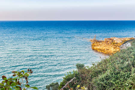 gargano: wooden construction of fishermen on the coast of the Gargano in Puglia Stock Photo