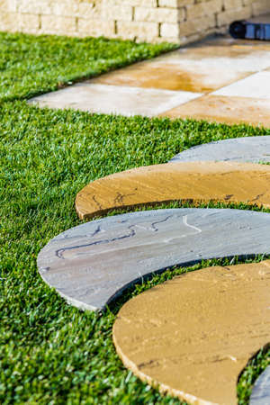 arranged: stone steps arranged in the grass Stock Photo