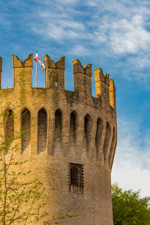 crenellated tower: waving flag of crenellated tower