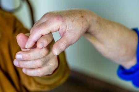 tenderly: the hand of an elderly man tenderly holding the hand of an elderly woman Stock Photo