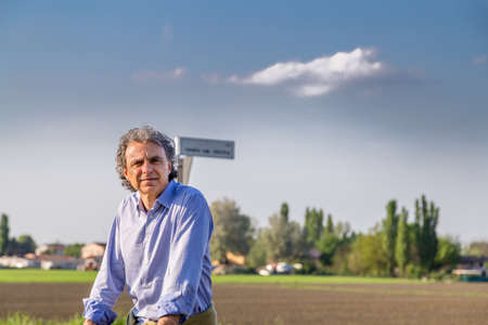 rolled up sleeves: middle-aged man in shirt with rolled up sleeves  in the countryside of Emilia Romagna