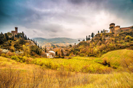 emilia: the green countryside around the fortress and the clock tower overlooking Brisighella in the Emilia Romagna in Italy
