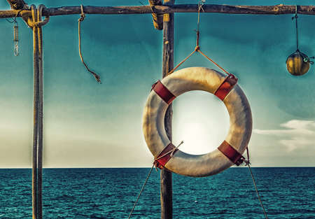 basic: lifesaver hanging on a basic wooden structure on the coast Stock Photo