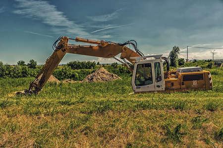 emilia: still crane and trees and green farmlands in Emilia Romagna in in Italy Stock Photo