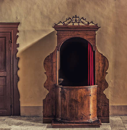 antique booth: Old wooden confessional in Italy