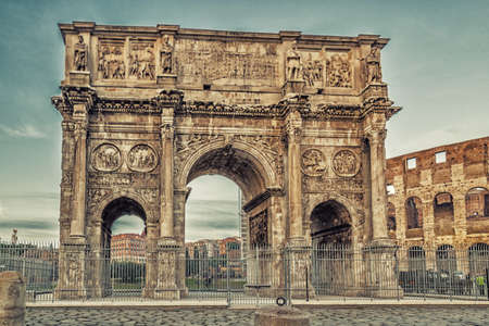 the imposing walls of a Roman triumphal arch and amphitheater