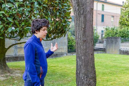 catalpa: young boy debating with himself in garden