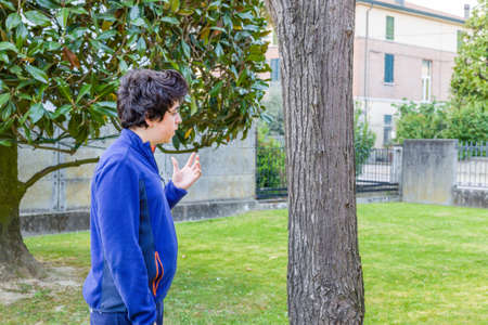 catalpa: young boy debating with himself in garden