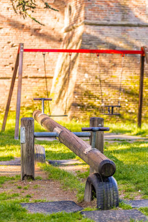 totter: trunk of seesaw in a playground Stock Photo
