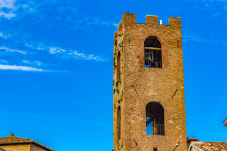 crenellated: Bell tower in a medieval village in Italy