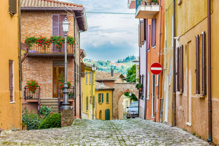 cobbled street of a medieval village on the hills of Romagna in Italy Stock Photo