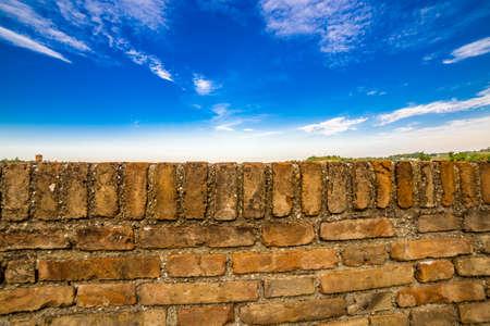 parapet: stone parapet on cloudy blue sky