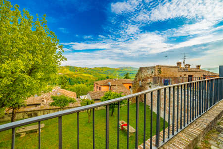 parapet: panorama of the hills of Romagna, with streets, houses and farmlands from stone parapet Stock Photo