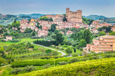 italian landscape: castle and houses of beautiful medieval village on a hilltop overlooking the valley