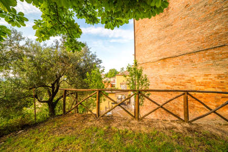 parapet wall: green areas of a Medieval Italian village Stock Photo