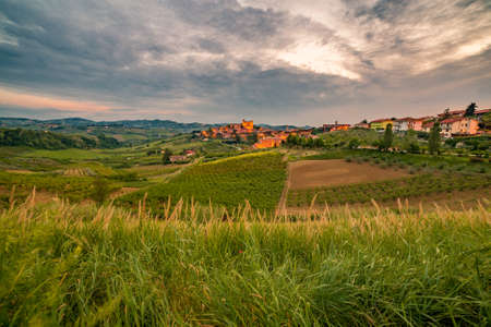 ad: Sunset on countryside around a medieval castle dating back to 1200 AD in Italy
