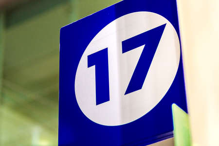 17: the number 17 on blue sign Stock Photo