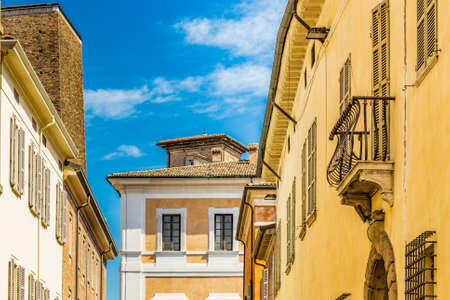grates: ancient buildings of the historic center of a town of Romagna in a sunny day
