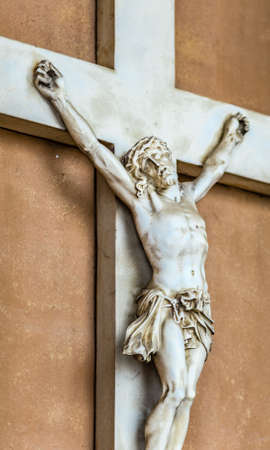 crucified: Details of marble statue of Crucified Jesus