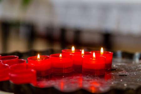votive: Cross formed of votive candles Stock Photo