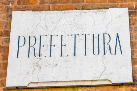plaque: marble plaque with Italian word meaning prefecture