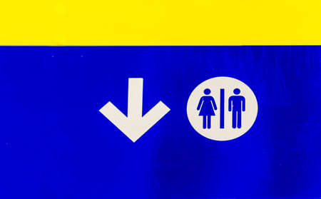 man and women wc sign: public bathrooms blue signal Stock Photo