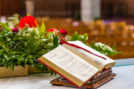 bible altar: Gospel book open on the altar