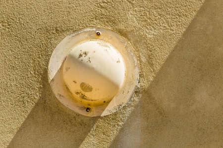 hemispherical: hemispherical cover on a yellow painted plaster wall