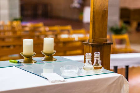 lectern: bottles of water and wine on the altar for the celebration of Holy Mass Stock Photo