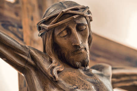 crucified: the face of Jesus crucified on the cross in a wooden statue