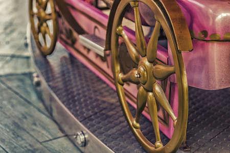 fake: close up of merry-go-round seats, fake wheels