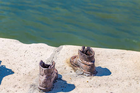 killings: Metal shoes on the Danube promenade, memorial in Budapest to the victims of the Holocaust Stock Photo