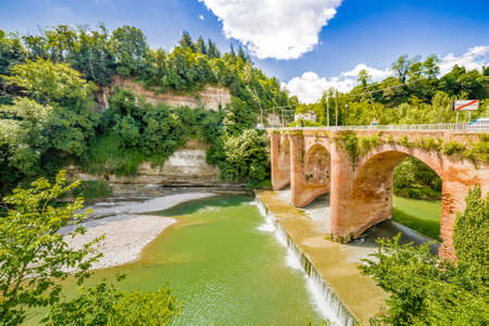 savio: fourteenth century bridge in masonry over the River in a small village in the hills in Romagna, Italy