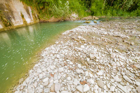 waters: the clear and transparent waters on the bed of a river on the green hills of Emilia Romagna in Italy Stock Photo