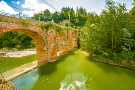 fourteenth: fourteenth century bridge in masonry over the River in a small village in the hills in Romagna, Italy
