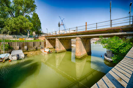 separates: the port channel that separates the Emilia Romagna from Marche in Italy